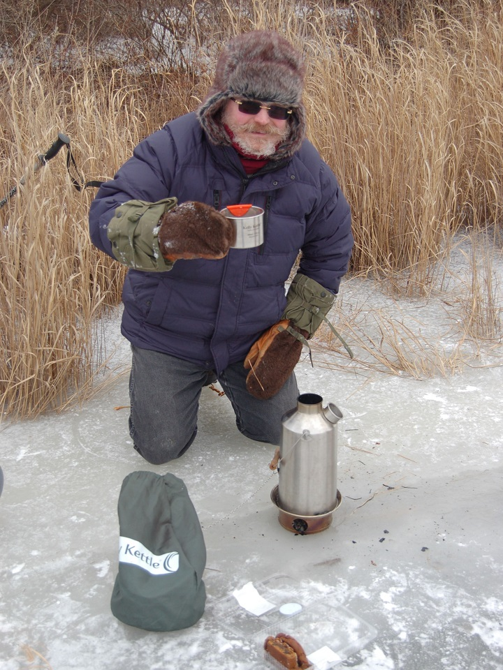 This is at the lake by our home. There was 14 inches of ice, and it was way below cold, about 0. But we all got warm and refreshed with our Kelly Kettle. The moral is, even with your home a few hundred yards home, using the Kettle is just fun, and a way to enjoy nature to the fullest.Thank you.