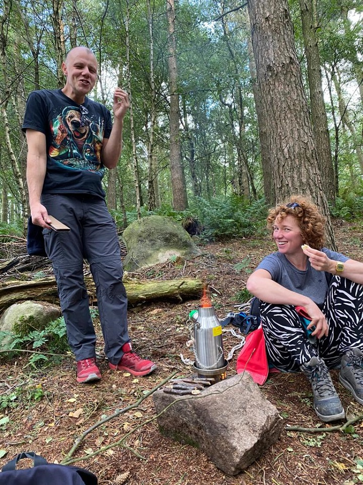 Family day in the woods, drinking tea and chilling in hammocks 'forest bathing'. (Stanton Moor Birchover Stone Circle, Derbyshire, U.K.)