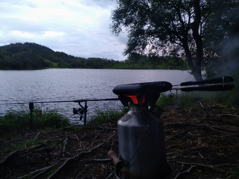 Carp fishing in Norway. Preparing a toast while making a cuppa. (Sveio, Norway)